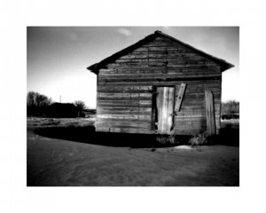 Wooden barn on the sandy soil