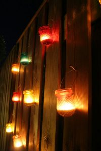 homemade mosquito repellent candles on the fence